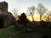 A winter dawn in a Cotswold churchyard at Brimpsfield, Gloucestershire