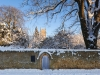 Winter snow on the Ernest Wilson Memorial Garden and St James church in the Cotswold town of Chipping Campden, Gloucestershire