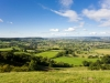 A view towards Coaley, Cam and Berkeley in the Severn Vale viewed from the Cotswold scarp at Coaley Peak Picnic Site, Gloucestershire