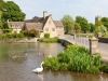 An old mill beside the River Coln in the Cotswold town of Fairford, Gloucestershire