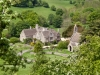 """Lasborough Manor and St Marys church in the Cotswold hamlet of Lasborough, Gloucestershire. The church was used as a location for filming scenes for BBC One's """"Lark Rise to Candleford"""""""