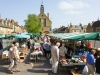 The regular Tuesday market in the High Street of the Cotswold town of Moreton in Marsh, Gloucestershire
