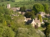 An early morning view of the Cotswold village of Naunton, in the valley of the infant River Windrush, Gloucestershire