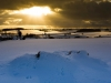 A winter sunset in the snow on the Cotswolds at Turkdean, Gloucestershire