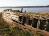One of the wooden barges deliberately beached on the banks of the River Severn to combat erosion at the Purton Hulks Ships Graveyard, Purton, Gloucestershire, England, UK