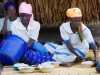 Women preparing nsima in the village of Nyombe, Malawi, Africa