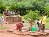 Women washing clothes near the village pump in the village of Chagamba, Malawi, Africa