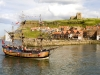 The tourist pleasure boat Bark Endeavour Whitby entering the harbour at Whitby, North Yorkshire